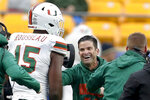 Miami defensive lineman Gregory Rousseau (15) celebrates with head coach Manny Diaz as their team leads with time running out against Pittsburgh in the second half of an NCAA college football game, Saturday, Oct. 26, 2019, in Pittsburgh. Miami won 16-12. (AP Photo/Keith Srakocic)