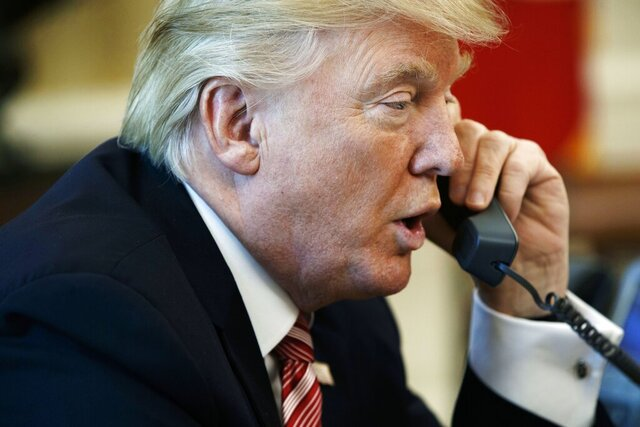 FILE - In this June 27, 2017, file photo, President Donald Trump talks on the telephone in the Oval Office of the White House in Washington. Trump's request of a