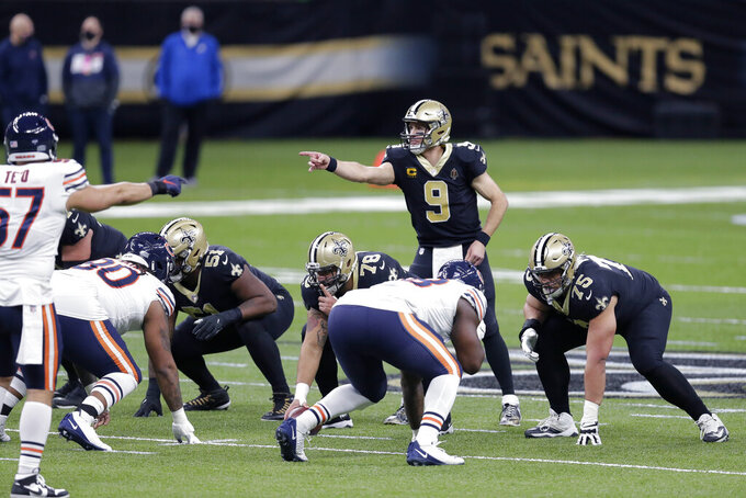New Orleans Saints quarterback Drew Brees (9) calls out a play from the line of scrimmage in the first half of an NFL wild-card playoff football game against the Chicago Bears in New Orleans, Sunday, Jan. 10, 2021. (AP Photo/Brett Duke)