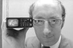 FILE  - In this Sept. 18, 1977 file photo, Clive Sinclair, founder of Sinclair Radionics, a New York-based firm, displays the Microvision television in New York. Sinclair, the British inventor and entrepreneur who arguably did more than anyone else to inspire a generation of children into a life-long passion for computers and gaming, has died. He was 81. Sinclair, who rose to prominence in the early 1980s with a series of affordable home computers that offered millions their first glimpse into the world of coding as well as the adrenaline rush of playing games on screens, died on Thursday, Sept. 17, 2021 morning after a long illness with cancer. (AP Photo/Dave Pickoff, File)