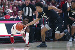 Colorado guard Daylen Kountz (2) battles for the ball with Stanford guard Daejon Davis (1) during the first half of an NCAA college basketball game in Stanford, Calif., Sunday, March 1, 2020. (AP Photo/Jed Jacobsohn)