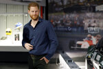 """FILE - In this Friday March 6, 2020, file photo, Britain's Prince Harry visits the Silverstone Circuit, in Towcester, England. In an episode of the """"Armchair Expert"""" podcast broadcast Thursday, May 13, 2021, Prince Harry compared his royal experience to being on """"The Truman Show"""" and """"living in a zoo."""" (Peter Nicholls/Pool Photo via AP, File)"""