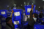 Election commission workers stacks ballot boxes in preparation for the presidential election scheduled for Sept 28, at the Independent Election Commission compound, in Kabul, Afghanistan, Wednesday, Sept. 18, 2019. Afghan officials say around 100,000 members of the country's security forces are ready for polling day. (AP Photo/Rahmat Gul)