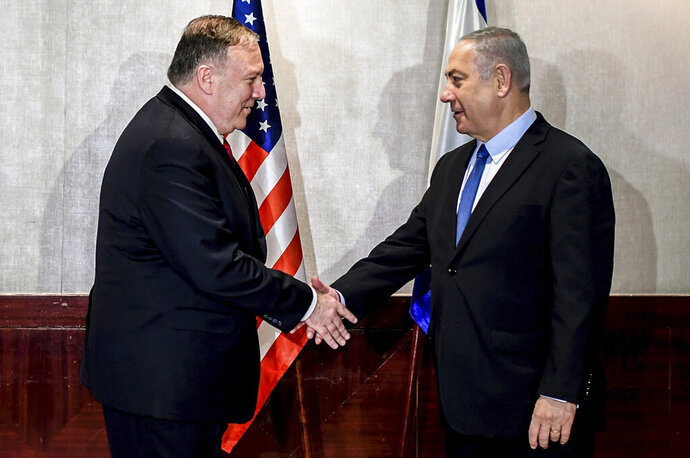 US Secretary of State Mike Pompeo and Israeli Prime Minister Benjamin Netanyahu shake hands during their meeting in Lisbon Wednesday, Dec. 4, 2019. (AP Photo/Patricia De Melo Moreira, Pool)