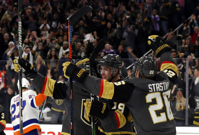 Vegas Golden Knights right wing Reilly Smith (19) celebrates after scoring against the New York Islanders during the second period of an NHL hockey game Saturday, Feb. 15, 2020, in Las Vegas. (AP Photo/Isaac Brekken)