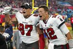 Tampa Bay Buccaneers tight end Rob Gronkowski, left, and quarterback Tom Brady celebrate after defeating the Kansas City Chiefs in the NFL Super Bowl 55 football game Sunday, Feb. 7, 2021, in Tampa, Fla. The Buccaneers defeated the Chiefs 31-9 to win the Super Bowl. (AP Photo/Ashley Landis)