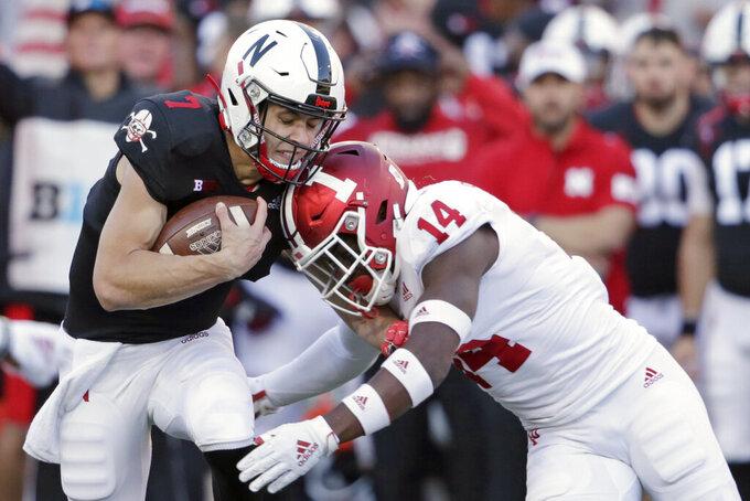 Indiana defensive back Andre Brown Jr. (14) tackles Nebraska quarterback Luke McCaffrey (7) during the second half of an NCAA college football game in Lincoln, Neb., Saturday, Oct. 26, 2019. Indiana won 38-31. (AP Photo/Nati Harnik)