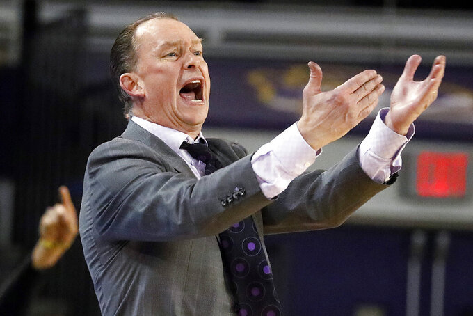 East Carolina coach Joe Dooley protests a call during the second half of the team's NCAA college basketball game against Houston in Greenville, N.C., Wednesday, Jan. 29, 2020. (AP Photo/Karl B DeBlaker)