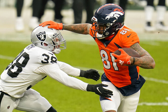 Denver Broncos wide receiver Tim Patrick (81) runs against Las Vegas Raiders strong safety Jeff Heath (38) during the first half of an NFL football game, Sunday, Jan. 3, 2021, in Denver. (AP Photo/Jack Dempsey)