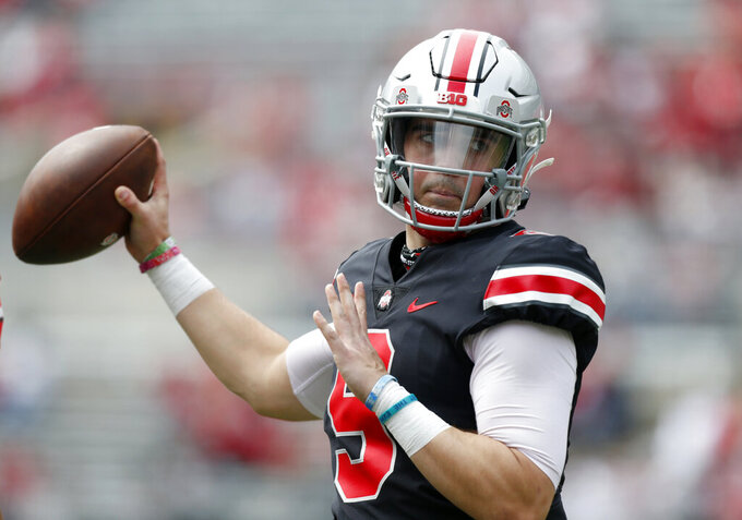 FILE - Ohio State quarterback Jack Miller throws on the sideline during an NCAA college spring football game in Columbus, Ohio, in this Saturday, April 17, 2021, file photo. With two-time Big Ten player of the year Justin Fields departing for the NFL, returning backups C.J. Stroud and Jack Miller III and five-star January enrollee Kyle McCord took the snaps in spring practice. Stroud was believed to be the front-runner entering the spring, but coach Ryan Day said a starter might not be determined until the week of the Sept. 2 opener at Minnesota.(AP Photo/Paul Vernon, File)