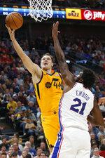 Utah Jazz forward Bojan Bogdanovic (44) goes to the basket as Philadelphia 76ers center Joel Embiid (21) defends in the first half during an NBA basketball game Wednesday, Nov. 6, 2019, in Salt Lake City. (AP Photo/Rick Bowmer)