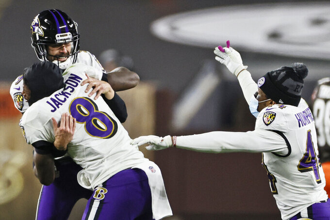Baltimore Ravens quarterback Lamar Jackson (8) celebrates with kicker Justin Tucker (9) after Tucker kicked a field goal during the second half of an NFL football game against the Cleveland Browns, Monday, Dec. 14, 2020, in Cleveland. The Ravens won 47-42. (AP Photo/Ron Schwane)