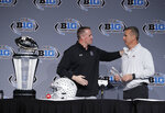 Northwestern head coach Pat Fitzgerald, left, talks with Ohio State head coach Urban Meyer during a news conference for the Big Ten Conference championship NCAA college football game, Friday, Nov. 30, 2018, in Indianapolis. Northwestern will play Ohio State on Saturday for the championship. (AP Photo/Darron Cummings)