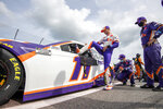 Denny Hamlin (11) enters his car before a NASCAR Cup Series auto race at Dover International Speedway, Saturday, Aug. 22, 2020, in Dover, Del. (AP Photo/Jason Minto)