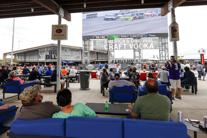 Fans watch the race on a jumbo tron in the new garage and fan area during the Sugarlands Shine 250 at Talladega Superspeedway, Saturday, Oct 12, 2019, in Talladega, Ala. (AP Photo/Butch Dill)