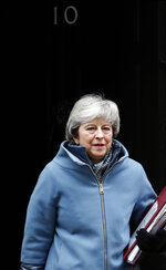 Britain's Prime Minister Theresa May leaves 10 Downing Street to attend the weekly Prime Ministers' Questions session, in parliament in London, Wednesday, March 6, 2019. Britain's chief law officer said Wednesday that Brexit negotiations with the European Union had got to