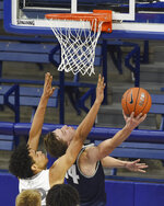 Air Force's Nikc Jackson is unable to keep Utah State's Justin Bean from scoring during the second half of an NCAA college basketball game Thursday, Dec. 31, 2020, at Air Force Academy, Colo. (Jerilee Bennett/The Gazette via AP)