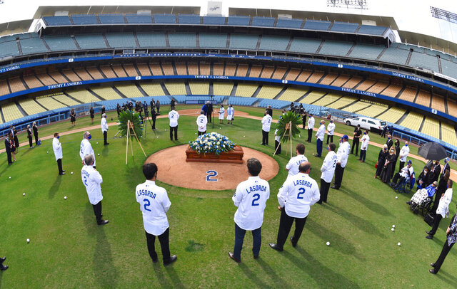 In this photo provided by the Los Angeles Dodgers, the casket of Hall of Fame manager Tommy Lasorda is seen on the mound during a ceremony at Dodger Stadium, Tuesday, Jan. 19, 2021, in Los Angeles. (Jon SooHoo/Los Angeles Dodgers via AP)