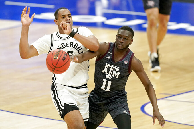 Texas A&M's Hassan Diarra (11) fouls Vanderbilt's D.J. Harvey (5) in the second half of an NCAA college basketball game in the Southeastern Conference Tournament Wednesday, March 10, 2021, in Nashville, Tenn. (AP Photo/Mark Humphrey)