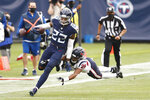 Tennessee Titans running back Derrick Henry (22) gets past Houston Texans cornerback Vernon Hargreaves III (26) as Henry runs for 53 yards in overtime of an NFL football game Sunday, Oct. 18, 2020, in Nashville, Tenn. The Titans won in overtime 42-36. (AP Photo/Wade Payne)