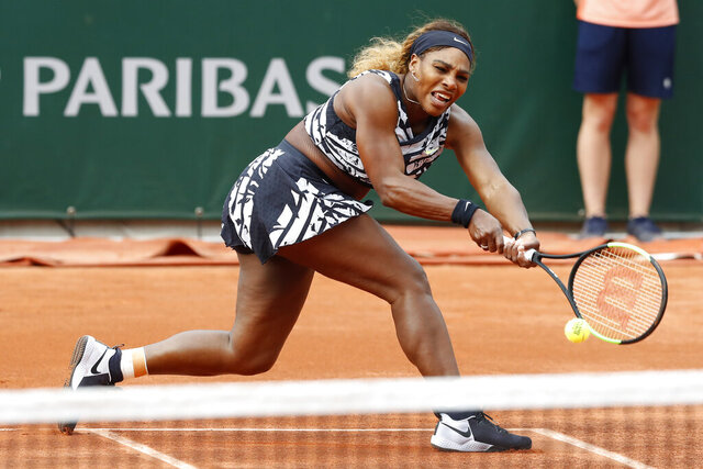 FILE - In this May 27, 2019, file photo, Serena Williams of the U.S. plays a shot against Vitalia Diatchenko of Russia during their first round match of the French Open tennis tournament at the Roland Garros stadium in Paris. If the French Open were being held as scheduled right now -- instead of postponed to September because of the coronavirus pandemic, Williams again would have had a shot at her 24th major to pull even with Margaret Court for the most in history. (AP Photo/Pavel Golovkin, File)