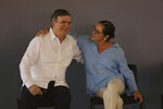 Mexico's Chancellor Marcelo Ebrard is embraced by his Salvadoran counterpart, Alexandra Hill, before the official launch of the