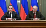 Russian President Vladimir Putin, right, and Russian Prime Minister Dmitry Medvedev attend a cabinet meeting in Moscow, Russia, Wednesday, Jan. 15, 2020. The Tass news agency reports Wednesday that Russian Prime Minister Dmitry Medvedev submitted his resignation to President Vladimir Putin. Russian news agencies said Putin thanked Medvedev for his service but noted that the prime minister's Cabinet failed to fulfil all the objectives set for it. (Alexei Nikolsky, Sputnik, Kremlin Pool Photo via AP)