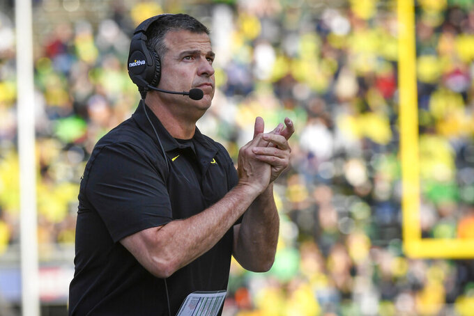 Oregon head coach Mario Cristobal applauds his teams effort during the second quarter of an NCAA college football game against Stony Brook Saturday, Sept. 18, 2021, in Eugene, Ore. (AP Photo/Andy Nelson)