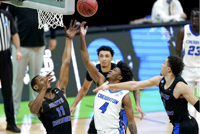 UC Santa Barbara's Brandon Cyrus (11) and Creighton's Shereef Mitchell (4) battle for a rebound during the second half of a college basketball game in the first round of the NCAA tournament at Lucas Oil Stadium in Indianapolis Saturday, March 20, 2021. (AP Photo/Mark Humphrey)