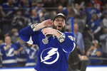 Tampa Bay Lightning right wing Nikita Kucherov reacts as the crowd cheers after the team defeated the Montreal Canadiens in Game 5 of the NHL hockey Stanley Cup finals, Wednesday, July 7, 2021, in Tampa, Fla. (AP Photo/Phelan Ebenhack)
