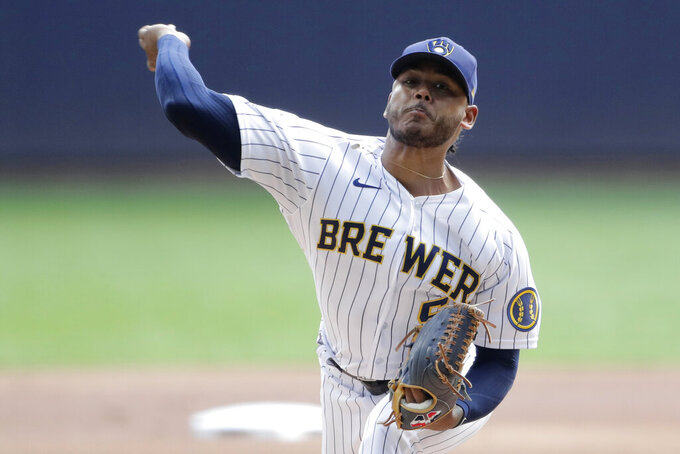 Milwaukee Brewers' Freddy Peralta pitches during the first inning of a baseball game against the New York Mets, Sunday, Sept. 26, 2021, in Milwaukee. (AP Photo/Aaron Gash)