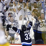 FILE - In this May 1, 2018, file photo, Winnipeg Jets' Dustin Byfuglien (33) celebrates after scoring against the Nashville Predators during the second period of an NHL hockey playoff game in Winnipeg, Manitoba. Winnipeg was already gripped by playoff fever. Now, with the Jets in the Western Conference final, the temperature is rising further. Jets merchandise is flying off shelves and downtown office workers are decked out in team jerseys. The passion surpasses the glory days of 40 years ago when the Jets were champions of the World Hockey Association. (Trevor Hagan/The Canadian Press via AP, File)