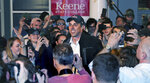 Former Texas congressman Beto O'Rourke smiles as he is surrounded while arriving for a campaign stop at Keene State College in Keene, N.H., Tuesday, March 19, 2019. O'Rourke announced last week that he'll seek the 2020 Democratic presidential nomination. (AP Photo/Charles Krupa)