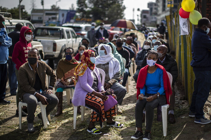 Ethiopians queue on chairs in the street as they wait to cast their votes in the general election at a polling center in the capital Addis Ababa, Ethiopia, Monday, June 21, 2021. Ethiopia was voting Monday in the greatest electoral test yet for Prime Minister Abiy Ahmed as insecurity and logistical issues meant ballots wouldn't be cast in more than 100 constituencies of the 547 across the country. (AP Photo/Ben Curtis)