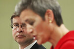 European Commission Vice Presidents Margrethe Vestager, right, and Valdis Dombrovskis participate in a media conference on the proposal for a Regulation to address distortions caused by foreign subsidies in the Single Market and on the European Industrial Strategy Update at EU headquarters in Brussels, Wednesday, May 5, 2021. (Yves Herman, Pool via AP)