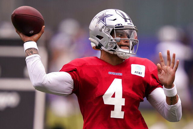 Dallas Cowboys quarterback Dak Prescott (4) passes during an NFL training camp football practice in Frisco, Texas, Thursday, Sept. 3, 2020. (AP Photo/LM Otero)
