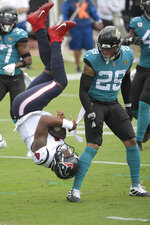 Houston Texans quarterback Deshaun Watson (4) is upended by Jacksonville Jaguars safety Josh Jones (29) while trying to score a touchdown during the first half of an NFL football game, Sunday, Nov. 8, 2020, in Jacksonville, Fla. (AP Photo/Phelan M. Ebenhack)