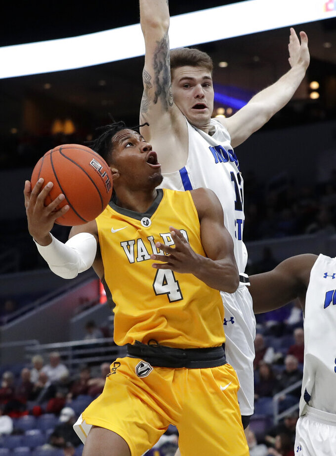 Valparaiso's Bakari Evelyn (4) looks to the basket as Indiana State's Clayton Hughes defends during the first half of an NCAA college basketball game in the first round of the Missouri Valley Conference men's tournament Thursday, March 7, 2019, in St. Louis. (AP Photo/Jeff Roberson)