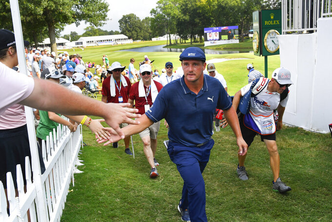 Bryson Dechambeau walks off the18th green after finishing the third round in the World Golf Championship-FedEx St. Jude Invitational tournament, Saturday, Aug. 7, 2021, in Memphis, Tenn. (AP Photo/John Amis)