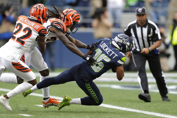 Seattle Seahawks wide receiver Tyler Lockett (16) scores a touchdown ahead of Cincinnati Bengals cornerback Dre Kirkpatrick, center, and William Jackson (22) during the second half of an NFL football game Sunday, Sept. 8, 2019, in Seattle. (AP Photo/Stephen Brashear)