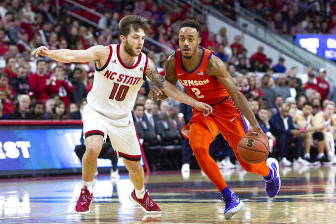 Clemson's Marcquise Reed (2) drives against North Carolina State's Braxton Beverly (10) during the second half of an NCAA college basketball game in Raleigh, N.C., Saturday, Jan. 26, 2019. (AP Photo/Ben McKeown)