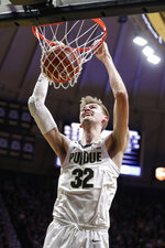 Purdue center Matt Haarms dunks against Minnesota during the second half of an NCAA college basketball game in West Lafayette, Ind., Thursday, Jan. 2, 2020. Purdue won 83-78 in double overtime. (AP Photo/Michael Conroy)