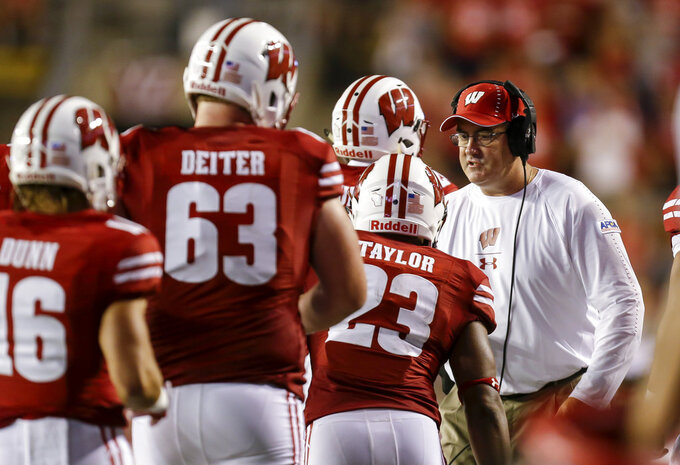 Wisconsin coach Paul Chryst, right, congratulates running back Jonathan Taylor (23) after Taylor scored a touchdown against Western Kentucky during the first half of an NCAA college football game Friday, Aug. 31, 2018, in Madison, Wis. (AP Photo/Andy Manis)