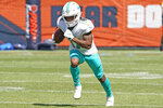 FILE - Miami Dolphins wide receiver Jaylen Waddle (17) warms up before an NFL preseason football game in Chicago, in this Saturday, Aug. 14, 2021, file photo. Dolphins quarterback Tua Tagovailoa will work with an upgraded cast of targets this season, including former Alabama teammate Jaylen Waddle, Miami's first draft pick.(AP Photo/David Banks)