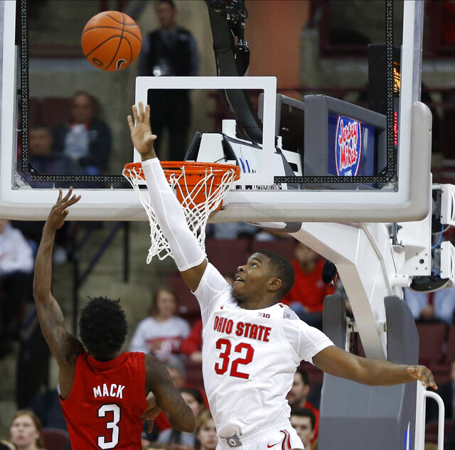 Nebraska's Cam Mack, left, tries to shoot over Ohio State's E.J. Liddell during the second half of an NCAA college basketball game Tuesday, Jan. 14, 2020, in Columbus, Ohio. Ohio State defeated Nebraska 80-68. (AP Photo/Jay LaPrete)