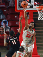 Houston forward Brison Gresham (55) blocks the shot of Western Kentucky guard Taveion Hollingsworth (11) during the first half of an NCAA college basketball game, Thursday, Feb. 25, 2021, in Houston. (AP Photo/Eric Christian Smith)