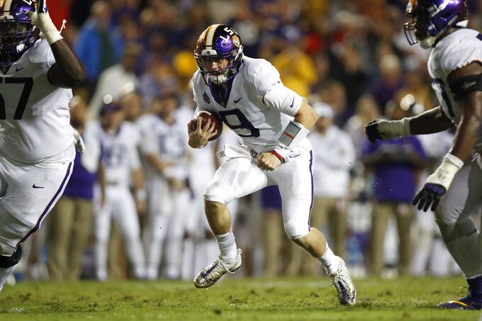 LSU quarterback Joe Burrow (9) runs the ball during an NCAA college football game against Mississippi State in Baton Rouge, La., Saturday, Oct. 20, 2018. LSU won 19-3. (AP Photo/Tyler Kaufman)