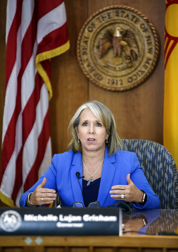 New Mexico Gov. Michelle Lujan Grisham speaks during a COVID-19 briefing at the state Capitol in Santa Fe, N.M., on Thursday, Aug. 13, 2020. (Gabriela Campos/Santa Fe New Mexican via AP)