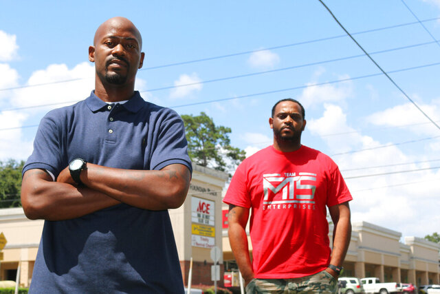 Kendrik Clemons, left, and Charles McMillon pose for a photo, Wednesday, Sept. 2, 2020, in Tallahassee, Florida. The two are raising concerns about an incident a week earlier in which a white couple in Tallahassee fired shots in what the men call a case of racial profiling by would-be vigilantes seeking street justice over something as petty as siphoned gasoline. They weren't injured but they worry whether the legal system is taking the case seriously enough. (AP Photo/Bobby Caina Calvan)