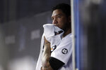 Miami Marlins starting pitcher Hector Noesi looks from the dugout after pitching during the first inning of a baseball game against the Philadelphia Phillies, Friday, Aug. 23, 2019, in Miami. (AP Photo/Lynne Sladky)